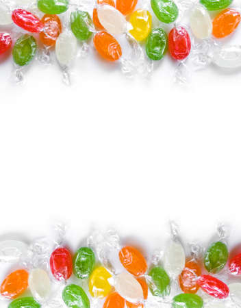 assorted colorful candies in plastic wraps isolated in white background photo