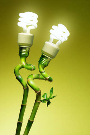 Conceptual image of two economic lamps as flowers on top of green canes photo
