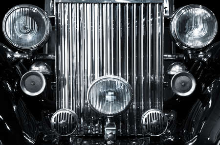 Monochromatic photo of the front grid and lights of a vintage car