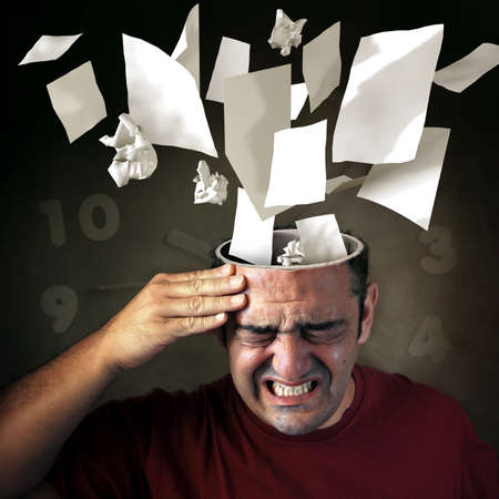Conceptual image of papers coming out of a mans head with pain expression  Stock Photo