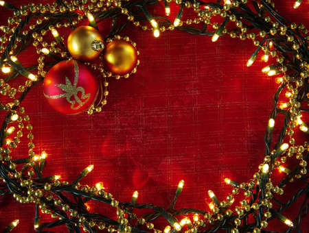 Christmas frame with decorative lights and red and yellow balls