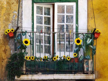 Flowery balcony in Alfama, a old neighborhood in Lisbon, Portugal.