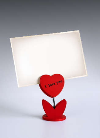 heart-shaped photo holder saying I Love You holding photo Stock Photo - 8631344