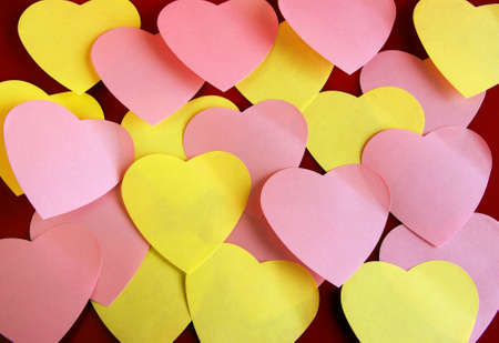 detach: Background of many heart-shaped colorful post its over red
