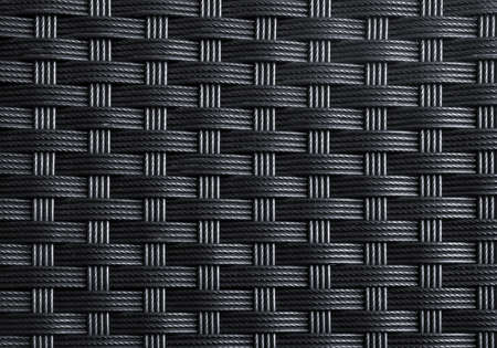 Black textured surface of interlaced nylon strings Stock Photo