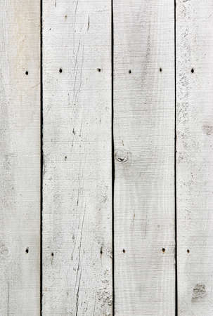 Background of old, cracked wooden planks painted white