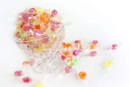 Assorted colorful candies in plastic wraps  photo