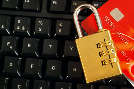 Shopping online concept with a credit-card and padlock over a computer keyboard Stock Photo - 9194350