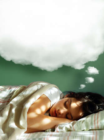 Young girl sleeping in her bed, with a dreaming fluffy balloon above her head
