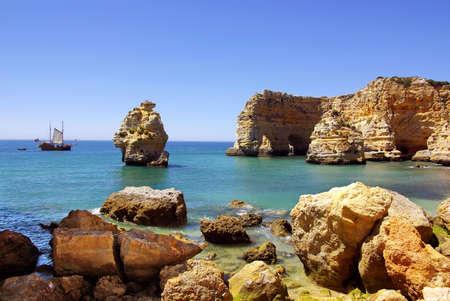 Natural beauty of rocky coastline in Algarve, Portugal photo