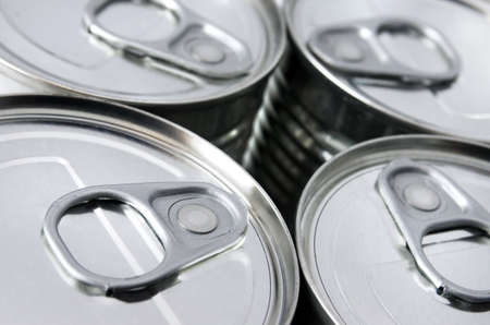 detail of the lids of four cans of conserved food photo
