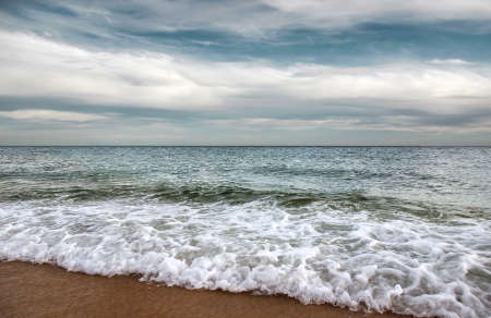 Beautiful seashore with calm waters and overcast sky Stock Photo - 9945160