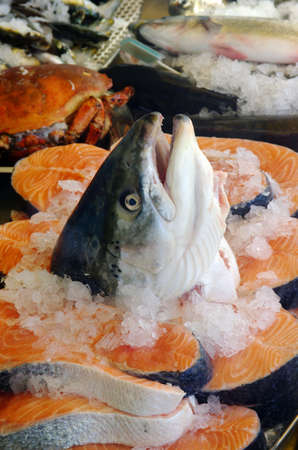Salmon head and slices for sale in a fish market photo