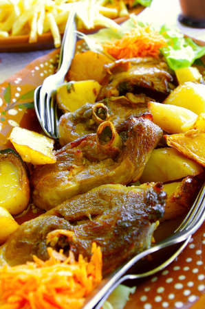 Portuguese presentation of the regional roasted lamb with potatoes photo