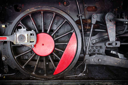 Detail of one wheel of a vintage steam train locomotive photo