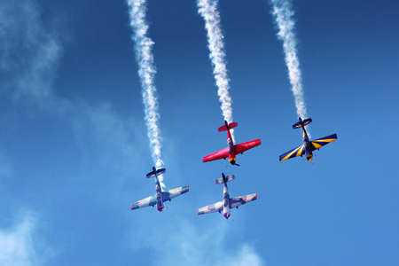 stunt: A formation of four airplanes in an aerobatic show Editorial