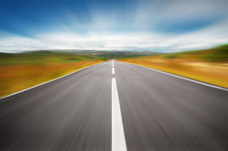 Empty road on the countryside with a speedy motion blur effect