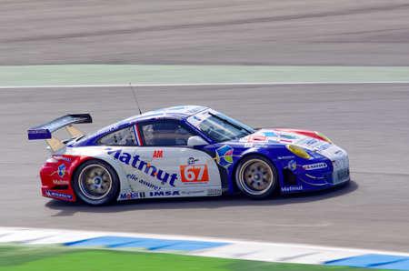 gt3: ESTORIL - SEPTEMBER 25: The Porsche 997 GT3 RSR of the team IMSA Performance Matmut is piloted by Raymond Narac in the LMS race 6 Hours Of Estoril on September 25, 2011, Estoril circuit, Portugal