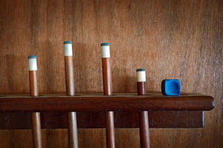 cue sports: Four Snooker sticks and blue chalk  Stock Photo