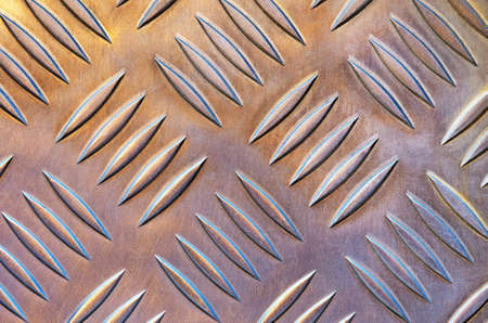 Background photo of a industrial metallic floor with bumpy pattern  photo