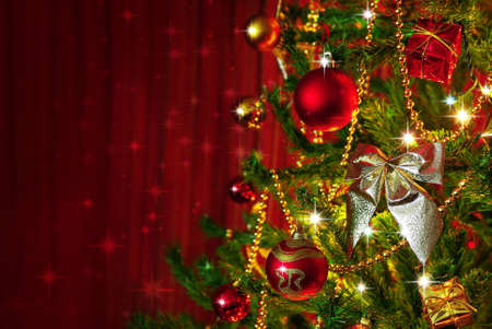 Detail of a Christmas tree next to red window curtains with copy space  photo