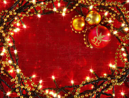 Christmas frame with decorative lights and red and yellow balls  photo