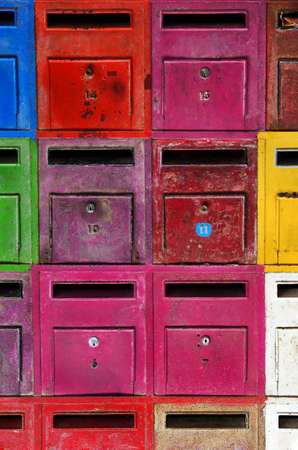 background of colorful old and rusty mailboxes Standard-Bild