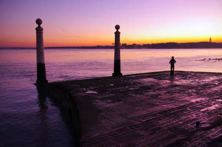 estuary: View of Columns Wharf in Commerce Square at sunset in Lisbon, Portugal Stock Photo