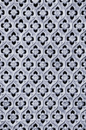 Pattern of tiles of a carved metallic floral artwork Stock Photo - 12421663