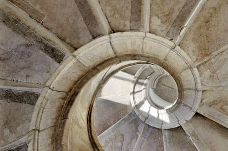 spiral stone stairway inside an old palace