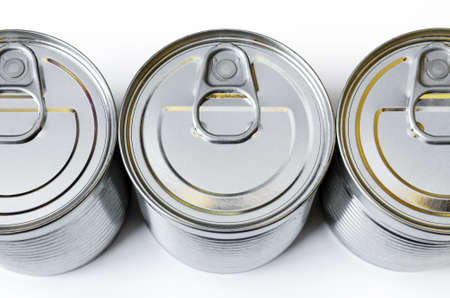 conserved: detail of the lids of three cans of conserved food  Stock Photo