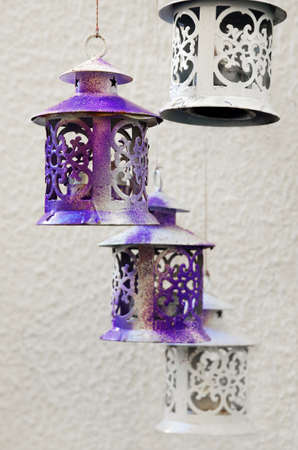 Decorative tin lanterns hanging with candles inside  Stock Photo - 12777266