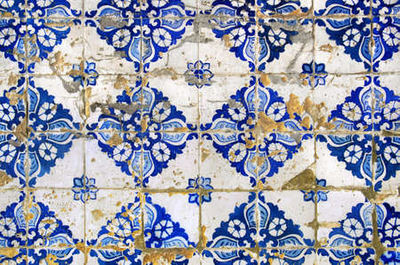 tile grout: background of old and damaged typical Portuguese tiles