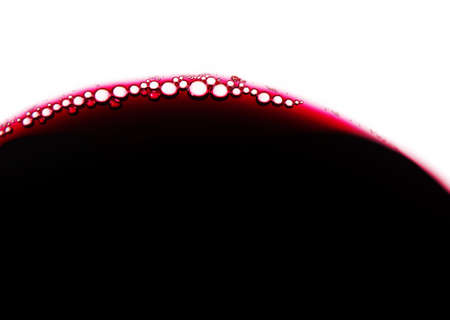 abstract liquor: Close-up of red wine bubbles in a transparent glass
