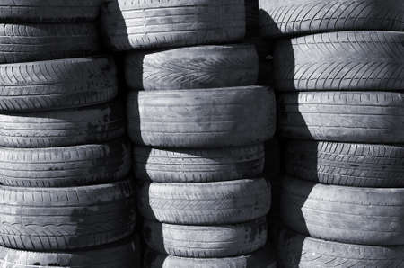 Piles of old and worn out automobile tires for recycling photo