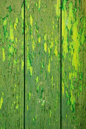 green door: Background of old wooden door with peeling green paint