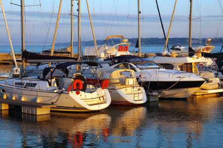 docked: Serene scene of a marina with docked yachts at sunset