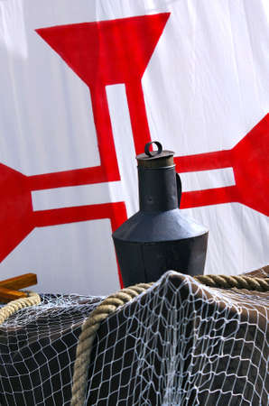caravel: Detail of a model of the historic portuguese Cross of Christ in the white sail of a acient ship