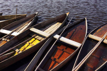 margins: Old wooden rowing boats in the margins of a lake Stock Photo