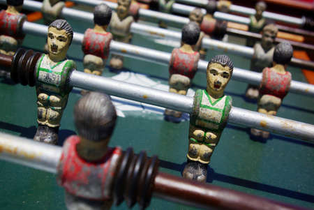 Closeup on miniature metallic ball players of a Fossball table game photo