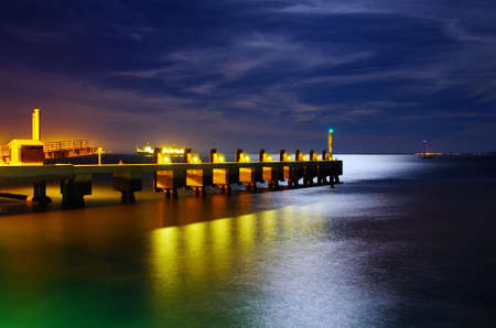 atmosphere construction: Calm atmosphere in a pier at night under a bright moonlight Stock Photo