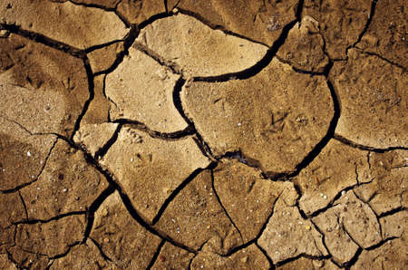 splitting up: Cracked and dried soil under a hot sunlight