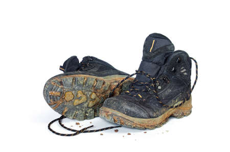 muddy clothes: A pair of dirty hiking boots isolated in white background Stock Photo