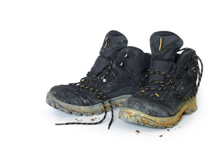 old shoes: A pair of dirty hiking boots isolated in white background Stock Photo