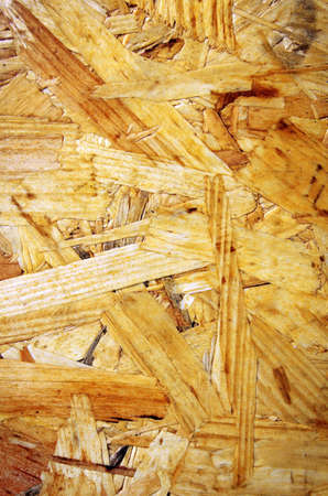 splinters: Yellow background surface of compressed yellow wood splinters and sawdust  Stock Photo