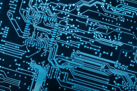 micro chip: close up background of a blue electronic circuit board  Stock Photo