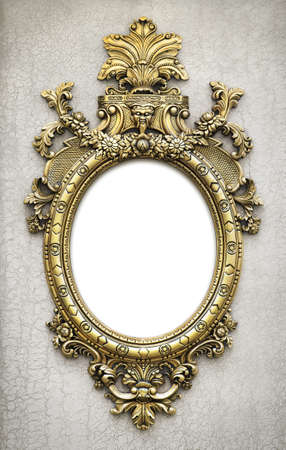 beautiful and complex golden baroque frame hanged on a textured wall photo
