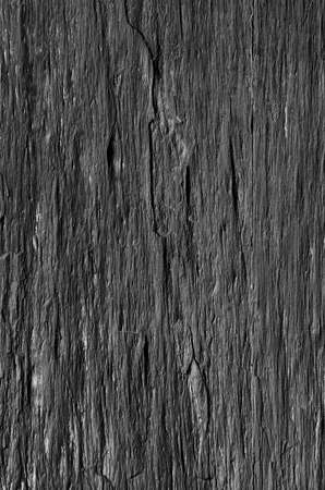 Fraction of a black schist wall with rough texture  photo