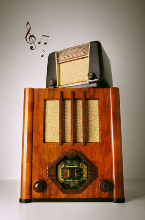 shortwave: Two old retro revival radios on top of another with music notes Stock Photo