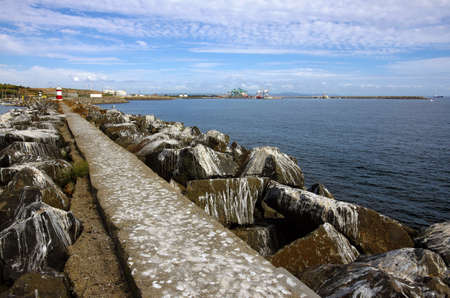 droppings: Long dirty stone pier all filled with seagull stinky droppings